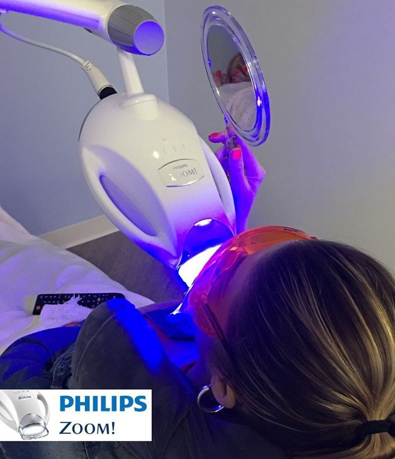 Patient receiving Zoom Teeth whitening treatment with the Philips logo in the bottom left corner.